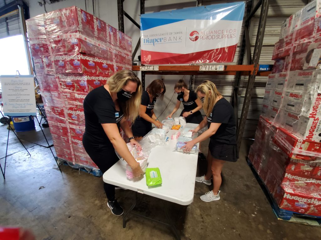 The Junior League of Tampa Diaper Bank Members pack diapers during COVID