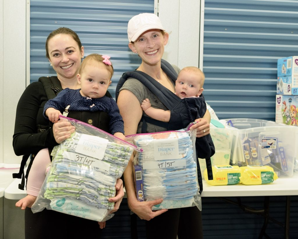 The Junior League of Tampa Diaper Bank Committee Members at monthly packing event